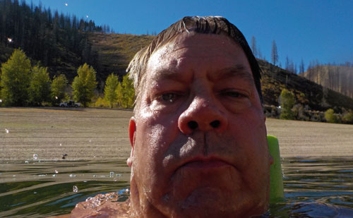 Tim Bondy swims at Idaho's Anderson Ranch Reservoir on Sept. 28, 2016.